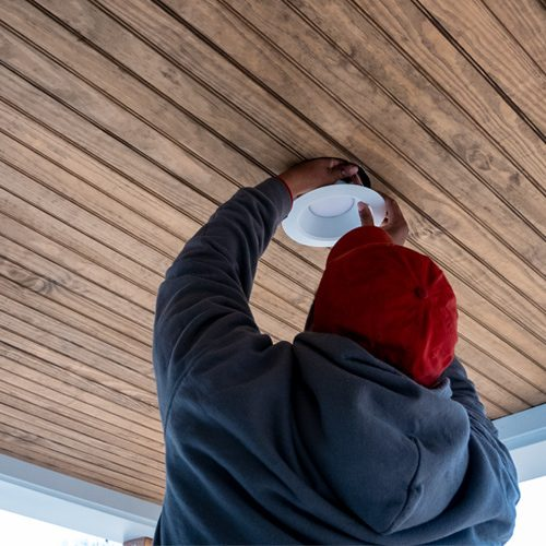 Rytec installing recessed lighting on exterior of home